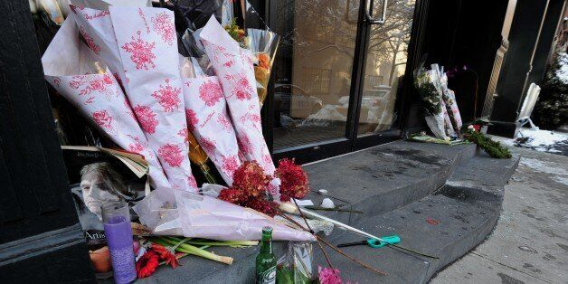 A makeshift memorial for actor Philip Seymour Hoffman at the entrance to the apartment building where he died February 4, 201