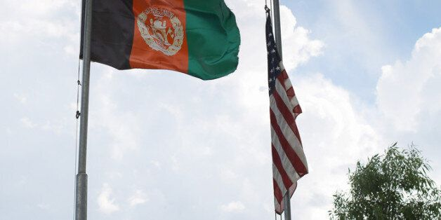 NANGALAM, AFGHANISTAN - JUNE 13:  The Afghan flag flies alongside the stars and stripes on Nangalam base on June 13, 2012 in