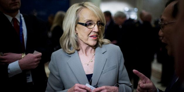 UNITED STATES - FEBRUARY 22: Arizona Governor Jan Brewer speaks with attendees of the National Governors Association Winter Meeting at the JW Marriott in Washington on Saturday, Feb. 22, 2014. (Photo By Bill Clark/CQ Roll Call)