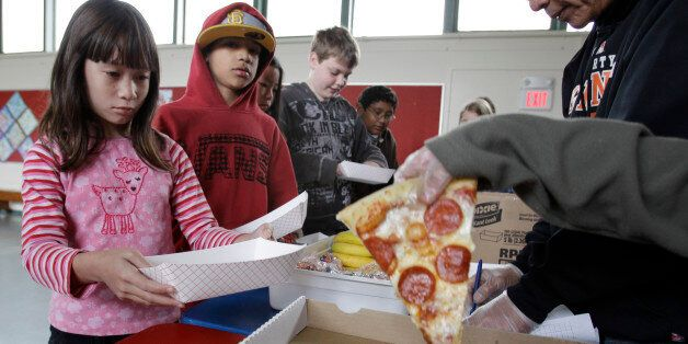 Fairmeadow Elementary School fourth grade student Juliet Lee, left, orders pepperoni pizza during a school lunch program in P