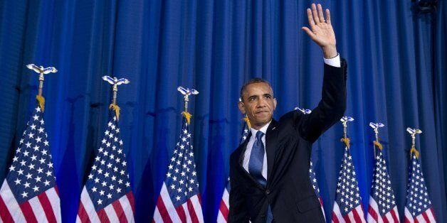 US President Barack Obama waves after speaking about his administration's drone and counterterrorism policies, as well as the