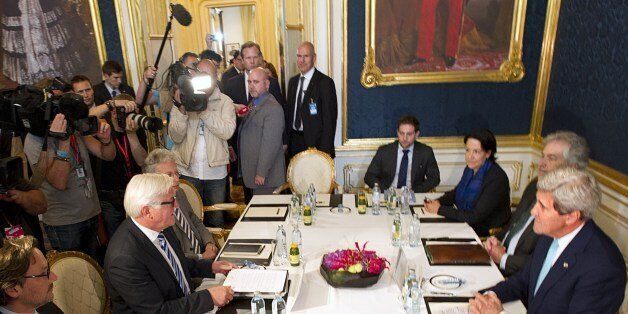 US Secretary of State John Kerry (R) sits in front of German Foreign minister Frank-Walter Steinmeier (2dL) as they meet at t