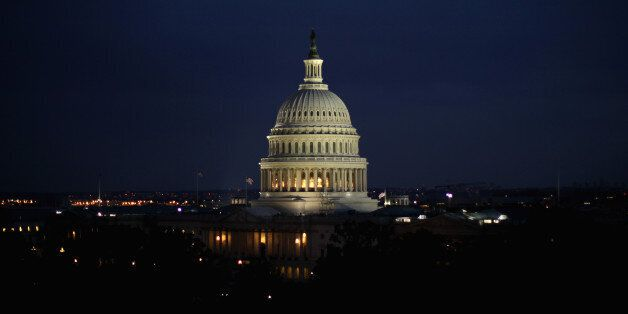 WASHINGTON, DC - JUNE 10:  The U.S. Capitol building is seen on the evening of June 10, 2014 in Washington, DC.  (Photo by Al