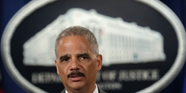 WASHINGTON, DC - JULY 14:  U.S. Attorney General Eric Holder speaks during a news conference for a major financial fraud anno