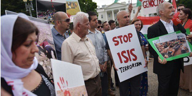 Demonstrators call for the end to Islamic State of Iraq and Syria (ISIS) terrorism during a Kurdish demonstration in front of