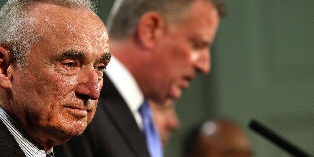 NEW YORK, NY - JULY 18:  New York Mayor Bill de Blasio (right) and New York Police Commissioner William Bratton speak to the