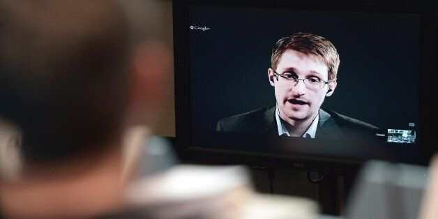 US National Security Agency (NSA) whistleblower Edward Snowden speaks to European officials via videoconference during a parl