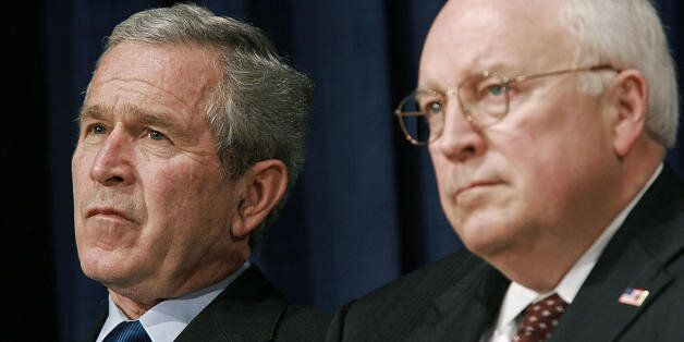 Washington, UNITED STATES:  US President George W. Bush (L) and Vice President Dick Cheney watche as Robert Gates delivers re