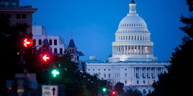 UNITED STATES - JULY 12: The U.S. Capitol as seen from Freedom Plaza on Pennsylvania Avenue on Saturday night, July 12, 2014.