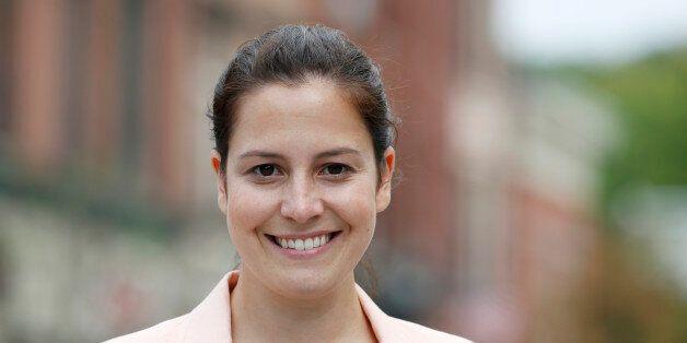 Republican Congressional candidate Elise Stefanik poses on Wednesday, Aug. 27, 2014, in Ballston Spa, N.Y. Stefanik is runnin