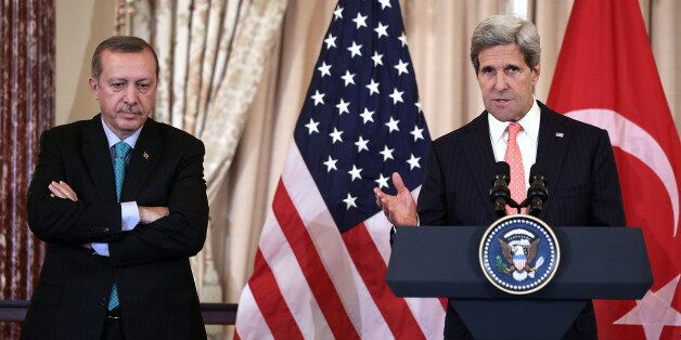 WASHINGTON, DC - MAY 16:  U.S. Secretary of State John Kerry (R) speaks as Prime Minister of Turkey Recep Tayyip Erdogan (L)