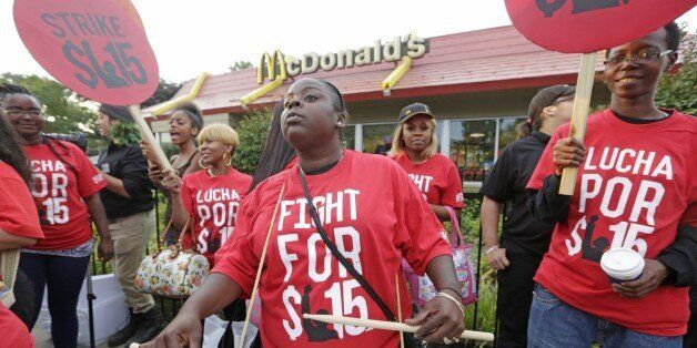 FILE - In this Sept. 14, 2014 file photo,  protesters participate in a rally outside a McDonald's on Chicago's south side a