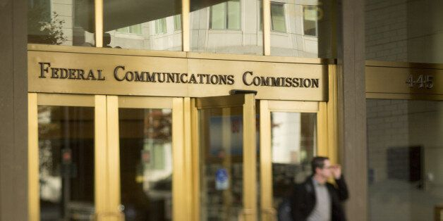 A man walks out of the Federal Communications Commission (FCC) headquarters in this photo taken with a tilt-shift lens in Was