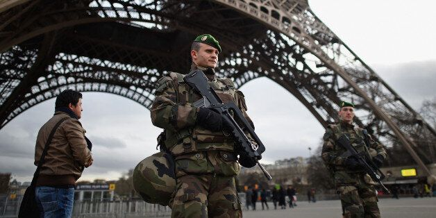 PARIS, FRANCE - JANUARY 12:  French troops patrol around the Eifel Tower on January 12, 2015 in Paris, France. France is set
