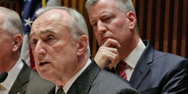 New York Mayor Bill de Blasio, right, listens as New York City Police Commissioner William Bratton addresses a news conferenc