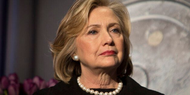 FILE - In this Friday, Nov. 21, 2014, file photo, Hillary Rodham Clinton listens before delivering remarks at an event in New