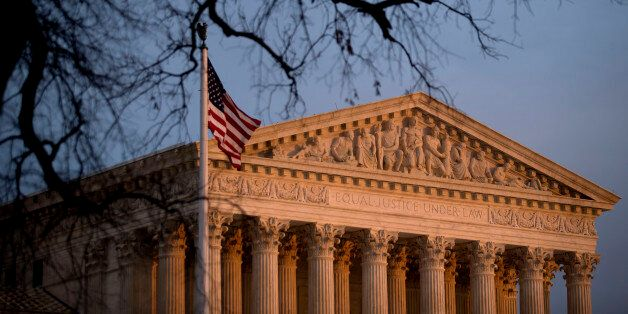 The U.S. flag flies in front of the Supreme Court building at sunset in Washington, D.C., U.S., on Tuesday, Dec. 9, 2014. Wor