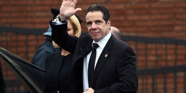New York Governor Andrew Cuomo arrives at a funeral home to attend a wake for New York Police Department (NYPD) officer Wenji