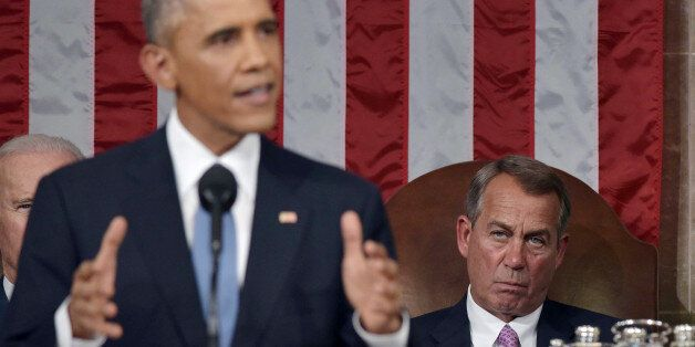 US Speaker of the House John Boehner (R) listens to US President Barack Obama deliver the State of the Union address before a