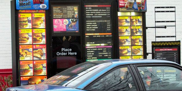 A customer places an order at the driveup menu board at a McDonald's in Newark, N.J., Tuesday, Feb. 8, 2005. New Jersey is co
