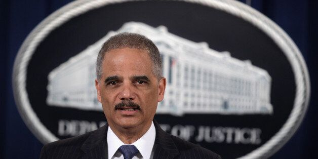 WASHINGTON, DC - FEBRUARY 03:  U.S. Attorney General Eric Holder speaks during a news conference to make a major financial fr