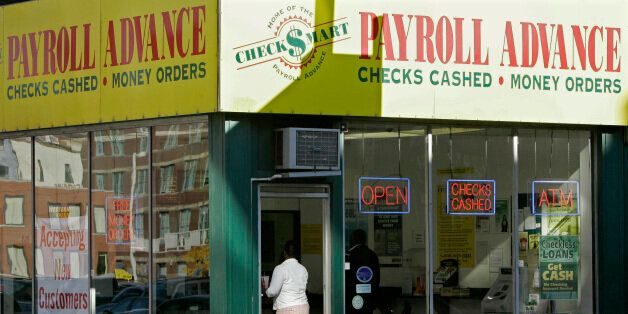 A customer enters a Payroll Advance location, Thursday, Nov. 6, 2008, in Cincinnati, Ohio. Voters approved an issue that upho