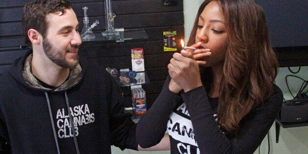 In this Feb. 20, 2015 photo, Peter Lomonaco, co-founder of the Alaska Cannabis Club, and CEO Charlo Greene share a joint at t
