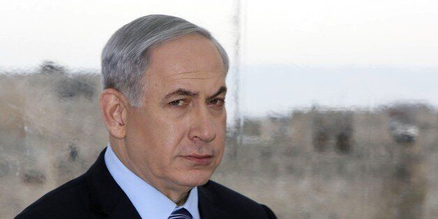 Backdropped by Jerusalem's Old City Ottoman walls, Israeli Prime Minister Benjamin Netanyahu looks on during a joint press conference with Jerusalem's mayor Nir Barkat (unseen) on February 23, 2015, a day after Barkat and his bodyguard apprehended a young Palestinian who stabbed an ultra-Orthodox Jew in Jerusalem. AFP PHOTO / GALI TIBBON (Photo credit should read GALI TIBBON/AFP/Getty Images)