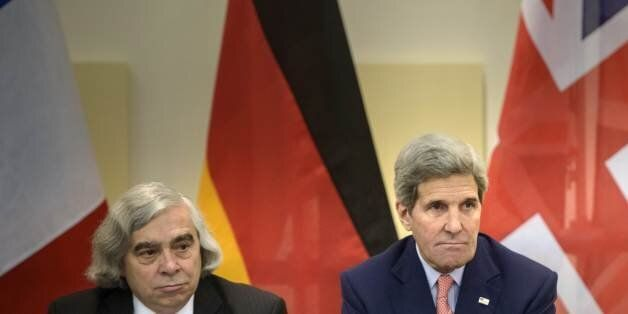 US Secretary of Energy, Ernest Moniz, left, and US Secretary of State, John Kerry wait for the start of a trilateral meeting