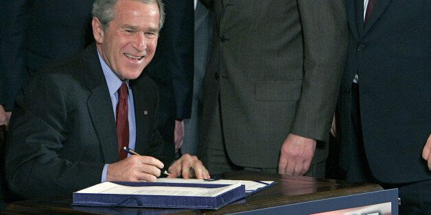 President Bush smiles as he starts to sign the USA Patriot Terrorism Prevention Reauthorization Act in the East Room of the W