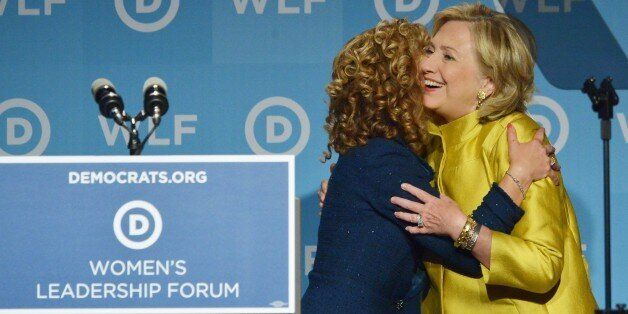 Former US Secretary of State Hillary Rodham Clinton (R) hugs DNC Chair Rep. Debbie Wasserman Schultz (L), D-FL, as Clinton ar