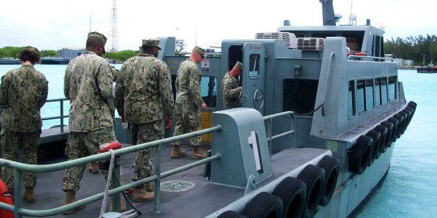 DIEGO GARCIA (Sep. 27, 2013) As part of familiarization training with local Maritime Prepositioned Forces, Seabees assigned t