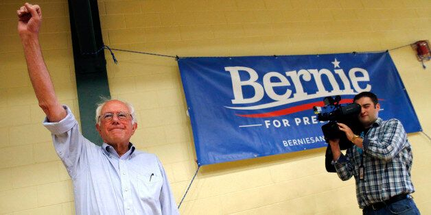 Democratic presidential candidate Sen. Bernie Sanders, I-Vt., waves to the crowd before speaking during a town hall meeting at Nashua Community College in Nashua, N.H., Saturday, June 27, 2015. (AP Photo/Michael Dwyer)
