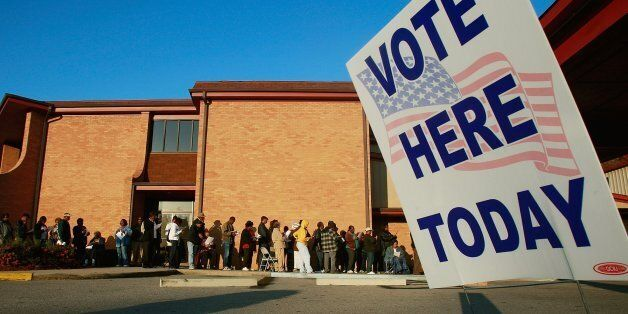 BIRMINGHAM, AL - NOVEMBER 04:  African-Americans line up to vote outside Bethel Missionary Baptist Church in the presidential