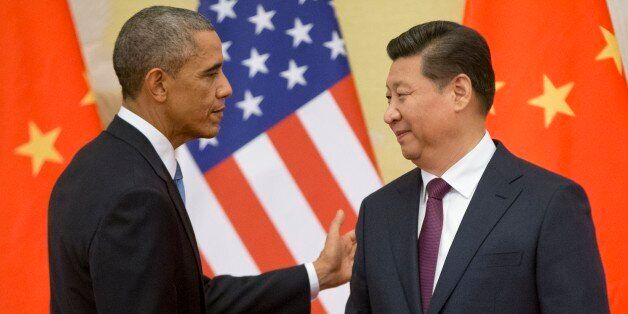 U.S. President Barack Obama, left,  and Chinese President Xi Jinping shake hands following the conclusion of their joint news