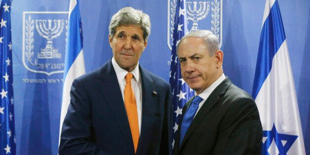 U.S. Secretary of State John Kerry, left, meets with Israeli Prime Minister Benjamin Netanyahu in Tel Aviv, Israel, Wednesday