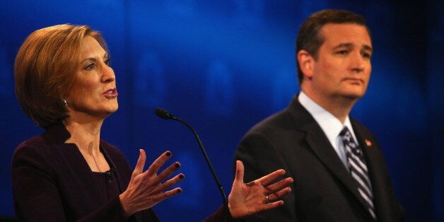 BOULDER, CO - OCTOBER 28:  Presidential candidate Carly Fiorina (L) while Sen. Ted Cruz (R-TX) looks during the CNBC Republic