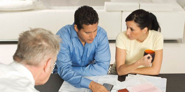 Businessman Assisting Couple with Credit Cards