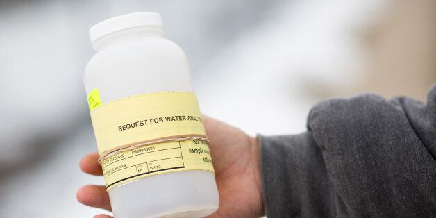 FLINT, MI - JANUARY 23:  A water collection device is handed out to citizens of Flint for testing  contaminated  water on Jan