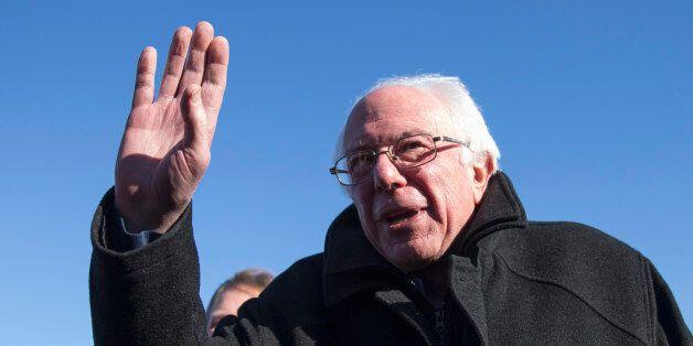 Democratic presidential candidate, Sen. Bernie Sanders, I-Vt. gestures as he speaks with media, Friday, Feb. 12, 2016, upon h