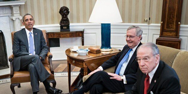 From left: US President Barack Obama, Senate Majority Leader Senator Mitch McConnell (R-KY) and Senator Chuck Grassley (R-IA)