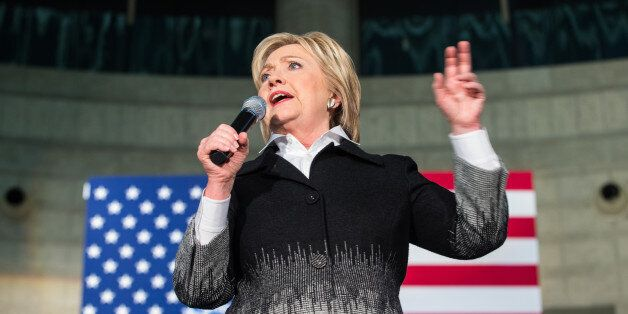 Democratic presidential candidate Hillary Clinton speaks during a rally in Detroit on March 7, 2016. / AFP / Geoff Robins