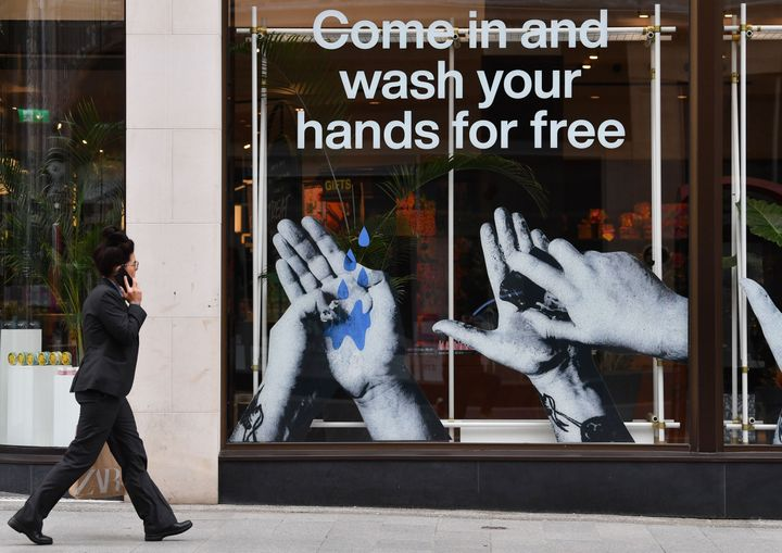 A cosmetics shop in Liverpool, northwest England, advertises free handwashing facilities inside. Health officials recommend f
