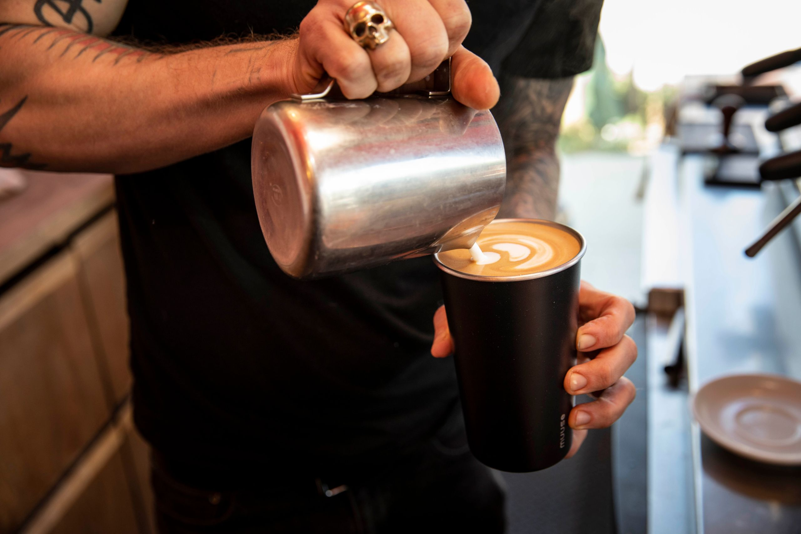 A barista at Ritual Coffee makes a latte in a reusable Muuse coffee cup. Ritual has been pilot testing the cups in its Hayes