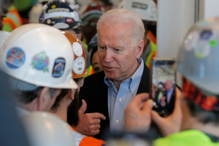 Former Vice President Joe Biden argues with a worker about his gun control policies during a campaign stop in Detroit.