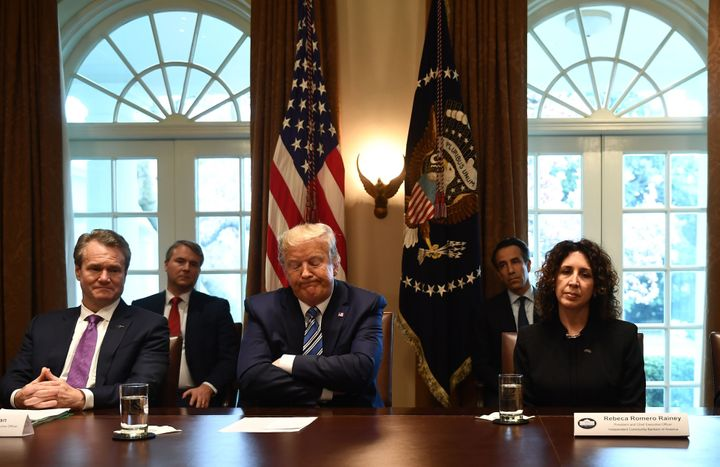 President Donald Trump reacts during a White House meeting with banking leaders to discuss how the financial services industr