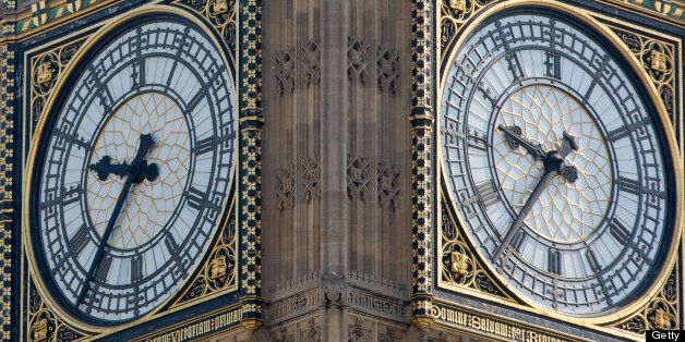 Clock faces sit in the Big Ben clock tower at the Houses of Parliament in London, U.K., on Monday, July 15, 2013. Britain's economy will grow faster this year than previously forecast as consumers cut into savings to keep spending, according to the Ernst & Young Item Club. Photographer: Jason Alden/Bloomberg via Getty Images