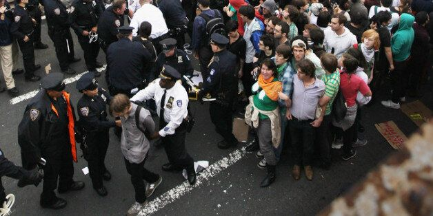 NEW YORK, NY - OCTOBER 01:  Police arrest two demonstrators affiliated with the Occupy Wall Street movement after they attemp