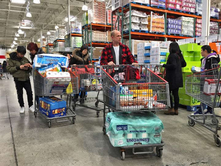 Canadians, including shoppers seen here in Markham, Ont., are stocking up on essential items during the COVID-19 outbreak.