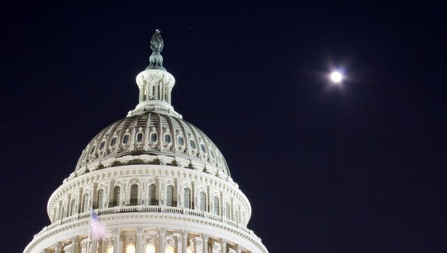 capitol dome with full moon  ...